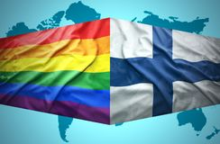 Waving Finnish and Gay flags. Of the political map of the world Stock Images
