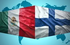 Waving Finnish and Mexican flags. Of the political map of the world Royalty Free Stock Image
