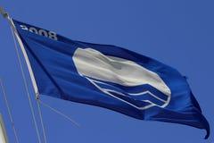 Waving flag. Flag waving against a blue sky Stock Photos