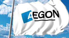Waving flag with Aegon N.V. logo against clouds and sky. 4K editorial animation stock footage