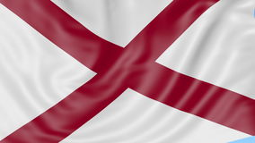 Waving flag of Alabama state against blue sky. Seamless loop 4K clip. ProRes stock video