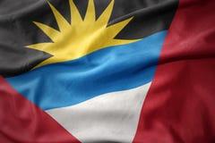Waving flag of antigua and barbuda. Waving colorful flag of antigua and barbuda Royalty Free Stock Image