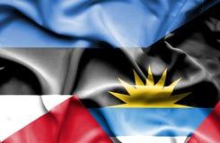 Waving flag of Antigua and Barbuda and Estonia royalty free stock photography