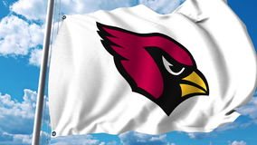 Waving flag with Arizona Cardinals professional team logo. Editorial 3D rendering Royalty Free Stock Images