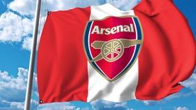 Waving flag with Arsenal football team logo. Editorial 3D rendering. Waving flag with Arsenal football team logo. Editorial 3D Royalty Free Stock Photo