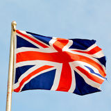 Waving flag in the blu e sky british colour and wave Stock Photo