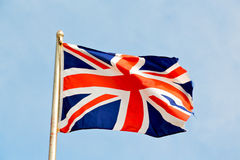 Waving flag in the blue sky british Stock Photography