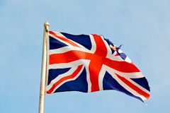 Waving flag in the blue sky. British colour and wave Royalty Free Stock Photos