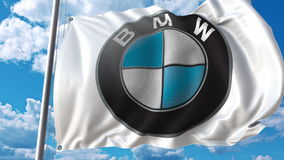 Waving flag with Bmw logo against sky and clouds. Editorial 3D rendering Stock Photography