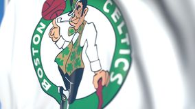 Waving flag with Boston Celtics team logo, close-up. Editorial loopable 3D animation stock video