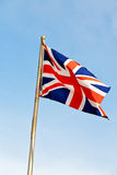Waving flag in the british colour and wave Stock Photo