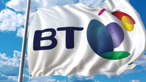 Waving flag with British Telecom BT logo against sky and clouds. Editorial 3D rendering. Waving flag with British Telecom BT logo against sky and clouds Stock Photos
