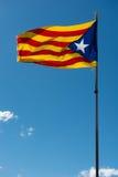 Waving flag of Catalonia. (Blue estelada) over blue sky background Royalty Free Stock Photos