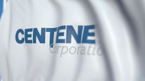 Flying flag with Centene Corporation logo, close-up. Editorial loopable 3D animation. Waving flag with Centene Corporation logo. Editorial 3D stock video