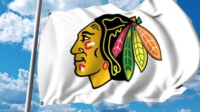 Waving flag with Chicago Blackhawks NHL hockey team logo. 4K editorial clip. Waving flag with Chicago Blackhawks NHL hockey team logo. 4K editorial animation stock illustration