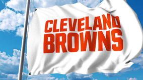 Waving flag with Cleveland Browns professional team logo. Editorial 3D rendering Stock Photos