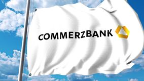 Waving flag with Commerzbank AG logo against clouds and sky. 4K editorial animation stock video footage