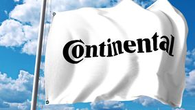 Waving flag with Continental AG logo against clouds and sky. Editorial 3D rendering Royalty Free Stock Photo