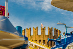 Waving flag of crenellated tower on carousel with airplanes Royalty Free Stock Photos