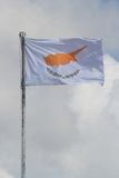 Waving flag of Cyprus on a flagpole against the sky Royalty Free Stock Images