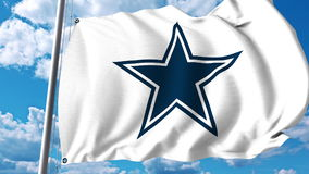 Waving flag with Dallas Cowboys professional team logo. Editorial 3D rendering Stock Photography
