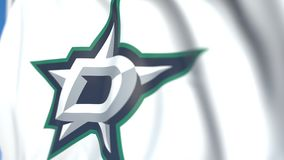 Waving flag with Dallas Stars NHL hockey team logo, close-up. Editorial loopable 3D animation stock video