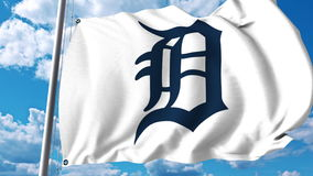 Waving flag with Detroit Tigers professional team logo. Editorial 3D rendering Stock Photography