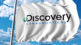 Waving flag with Discovery Communications logo. Editoial 3D rendering. Waving flag with Discovery Communications logo. Editorial 3D Royalty Free Stock Photo