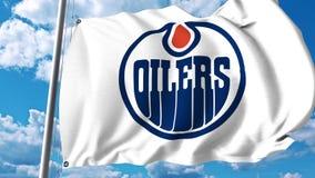 Waving flag with Edmonton Oilers NHL hockey team logo. 4K editorial clip. Waving flag with Edmonton Oilers NHL hockey team logo. 4K editorial animation stock illustration