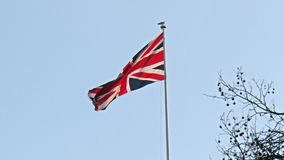 A waving flag of England in the pole stock footage