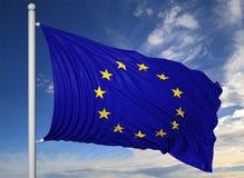 Waving flag of EU on flagpole Royalty Free Stock Image