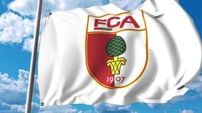 Waving flag with FC Augsburg football club logo. 4K editorial clip. Waving flag with FC Augsburg football club logo. 4K editorial animation stock illustration