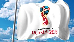 Waving flag with 2018 FIFA World Cup logo against sky background. Editorial 3D rendering Royalty Free Stock Photos