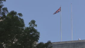 Waving flag of Great Britain. London. England. United Kingdom. Architecture and details of the city stock video