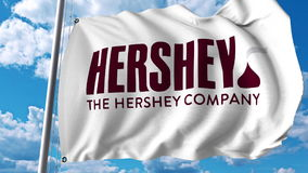 Waving flag with The Hershey Company logo. Editoial 3D rendering. Waving flag with The Hershey Company logo. Editorial 3D Stock Photography