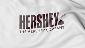 Waving flag with The Hershey Company logo. Editorial 3D rendering Stock Image
