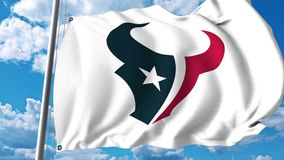 Waving flag with Houston Texans professional team logo. 4K editorial clip