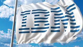Waving flag with IBM logo against moving clouds. 4K editorial animation