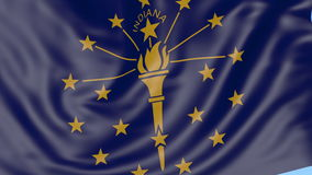 Waving flag of Indiana state against blue sky. Seamless loop 4K clip stock footage