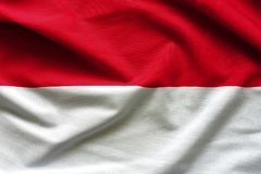 Waving flag of Indonesia, Asia. Close up fabric background royalty free stock image
