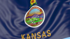 Waving flag of Kansas state against blue sky. Seamless loop 4K clip. ProRes stock footage