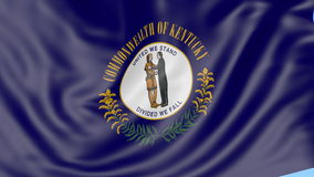 Waving flag of Kentucky state against blue sky. Seamless loop 4K clip. ProRes stock video