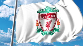 Waving flag with Liverpool football team logo. Editorial 3D rendering