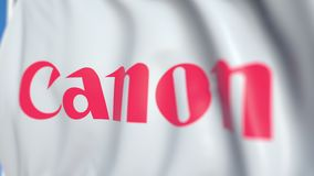 Waving flag with Canon Inc. logo, close-up. Editorial loopable 3D animation stock illustration