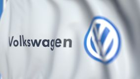 Waving flag with Volkswagen logo, close-up. Editorial loopable 3D animation stock illustration