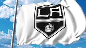Waving flag with Los Angeles Kings NHL hockey team logo. 4K editorial clip. Waving flag with Los Angeles Kings NHL hockey team logo. 4K editorial animation stock illustration