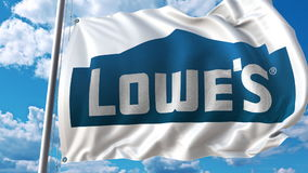 Waving flag with Lowe`s logo against sky and clouds. Editorial 3D rendering Stock Photo