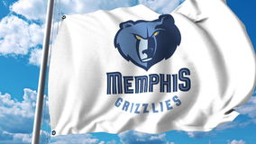 Waving flag with Memphis Grizzlies professional team logo. Editorial 3D rendering Stock Photography
