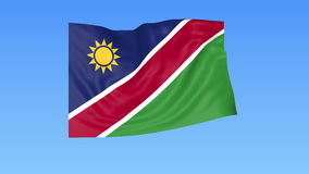 Waving flag of Namibia, seamless loop. Exact size, blue background. Part of all countries set. 4K ProRes with alpha. Flapping flag of Namibia, blue background vector illustration