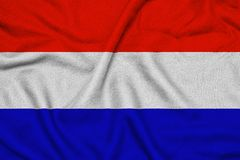 Waving flag of the Netherlands with textural folds stock images